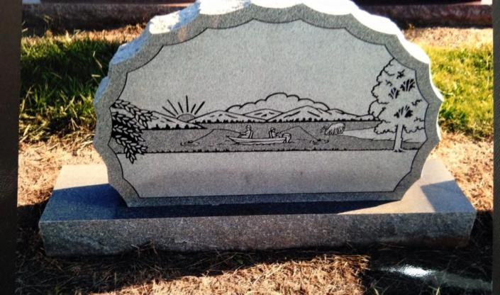 [Image: A sketched monument with a one of kind scene offers a more personalized option for a grave marker. ]